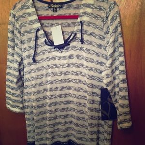 Absolutely famous 3/4  blue & white sweater.